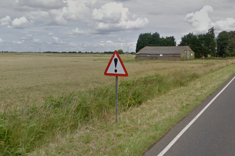 "An unhelpful ""Damaged Road Surface"" sign"